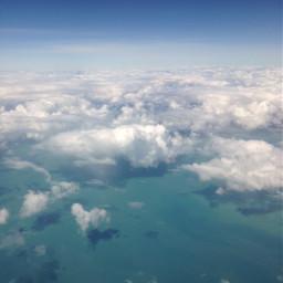 plane clouds sea shadows